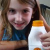 Linnea holds a bottle of camel milk